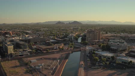 parkoló : Phoenix Arizona Aerial v11 Flying low over downtown Scottsdale area panning sunset cityscape 916 Stock mozgókép