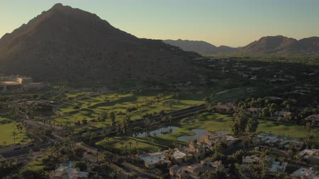 çimenli yol : Phoenix Arizona Aerial v13 Flying low over Phoenician Golf Club area panning sunset 916