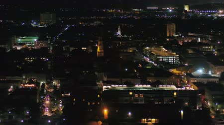 gümrük : South Carolina Charleston Aerial v10 Birdseye night view traversing North to South French Quarter 1017 Stok Video