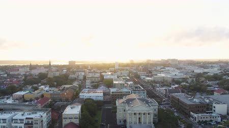 gümrük : South Carolina Charleston Aerial v127 Flying low to high around French Quarter with city view at sunset 1017