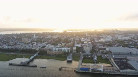 gümrük : South Carolina Charleston Aerial v128 Flying low to high backwards around French Quarter and port with city view at sunset 1017
