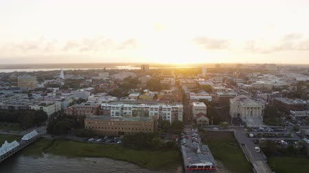 gümrük : South Carolina Charleston Aerial v135 Cityscape view flying in reverse over French Quarter and river 1017 Stok Video