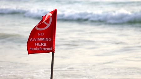 tenger : no swimming warning red flag tropical beach