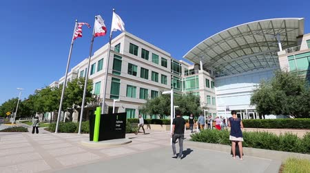 apple headquarter : Cupertino, CA, USA - August 15, 2016: people walking in front of the Apple world headquarters at One Infinite Loop. Apple is a multinational corporation that produces technology devise.