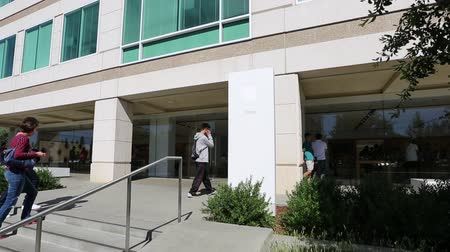 apple headquarter : Cupertino, CA, USA - August 15, 2016: people get inside Apple store of Apple Inc HQ at One Infinite Loop. Apple is a multinational corporation that produces consumer electronics, computers, software.