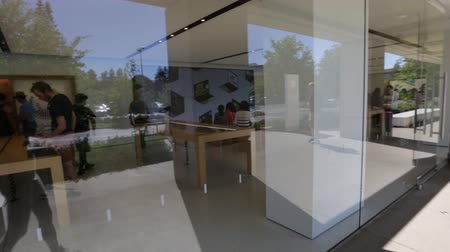 apple headquarter : Cupertino, CA, USA - August 15, 2016: people inside the popular Apple store of Apple Inc Headquarters at One Infinite Loop located in Cupertino, Silicon Valley, first persion view.