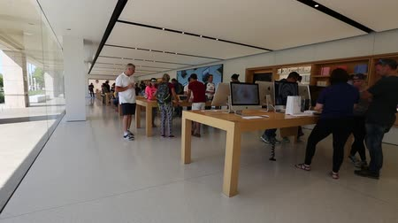 apple sign : Cupertino, CA, USA - August 15, 2016: people inside the Apple store of Apple Inc HQ at One Infinite Loop. Apple is a multinational corporation that produces consumer electronics, computers, software.