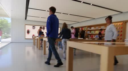 apple headquarter : Cupertino, CA, USA - August 15, 2016: people inside the Apple store of Apple Inc HQ at One Infinite Loop. Apple is a multinational corporation that produces consumer electronics, computers, software.