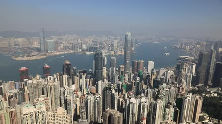 observation deck : Hong Kong, China - December 7, 2016: 180 degrees panorama of Victoria Harbour skyline in a sunny day view from observation deck of Peak Galleria.