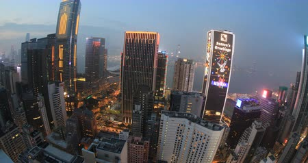 небоскреб : Hong Kong, China - December 10, 2016: Aerial view of Hong Kong panorama in the evening from Wooloomooloo Bar, on rooftop of famous The Hennessy palace, in Wan Chai district.