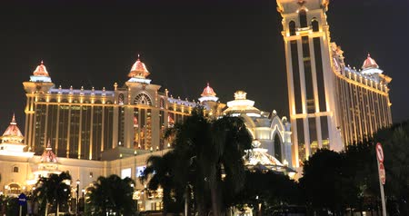 tiras : Macau, China - December 8, 2016: night tilt view of colorful Galaxy Macau Resort Hotel Casino in Cotai Strip. Macau is the gambling capital of Asia and is visited by over 25 million people every year.