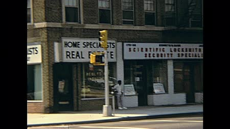seventy : New York city, United States of America - circa 1970: vintage video about Typical storefronts and old buildings by the road of lower east side Manhattan.