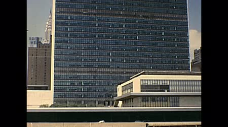 семидесятые годы : New York, United States of America - circa 1970: vintage footage of United Nations headquarter building from bottom square.