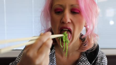 took : Slow motion on glamour woman eating green Japanese Chuka Wakame, sesame seaweed salad with chopsticks. In Japanese Asian fusion restaurant. Healthy food, light diet concept. Stock Footage