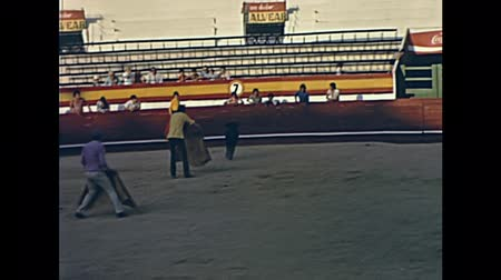 baleár : Ibiza, Spain - circa 1973: Many bullfighters bullfighting a young bull in the arena El Coliseo de San Rafael. Famous bullring from 1961 to 1985. With traditional typical clothing.