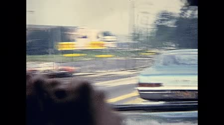 Массачусетс : Bristol County, Massachusetts, United States of America - circa 1970: point of view tourist of driving car in Bristol County. Vintage cars on the road traffic in 70s. Стоковые видеозаписи