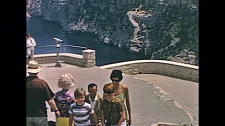 ações : MAJORCA, SPAIN - circa 1970: Majorca historical footage of a tourist family in typical 70s vintage outfits visiting famous Mirador de Es Colomer lookout. Stock Footage