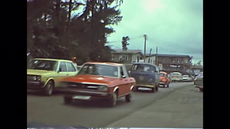 volkswagen : LAGOS, SOUTHERN NIGERIA, AFRICA - 1976: historical footage driving on traffic roads of Lagos town. Vintage trucks and cars like volkswagen beetle and T2 camper Bus Vanagon Van.