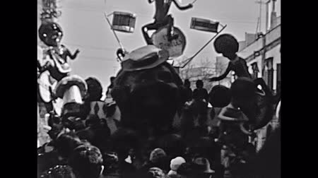 восстановлено : Marghera, Italy - circa 1960: Historic chariot of traditional Venice carnival. Chariot representing the Beatles characters. Historical restored footage.