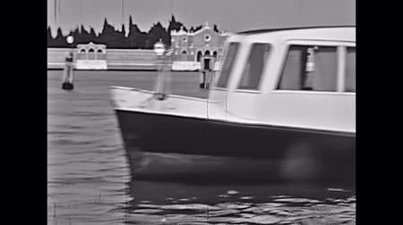 восстановлено : Venice, Italy - circa 1960: historical touristic boat tour from Venezia to Murano island. Close up on San Michele cemetery walls in venetian lagoon. Historical restored footage