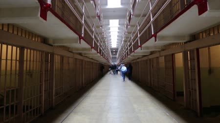 vezetett : San Francisco, United States - August 14, 2016: tourists visiting Alcatraz prison in main corridor tilt shift from ground cells to upper cells on both sides on three levels. Historical landmark.