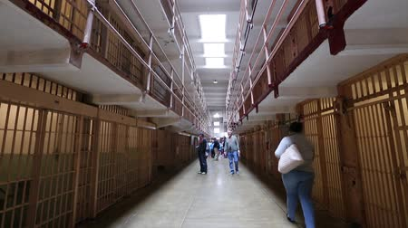 бронированный : Alcatraz prison, San Francisco, United States - August 14, 2016: main room with three rows of cell blocks on three levels.Tilt shift view with people on tour. Popular tourist San Francisco attraction