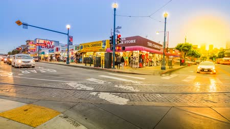 san francisco : San Francisco, California, United States - August 14, 2016: Crossroad time lapse on Jefferson and Janes roads at sunset. Tourists, buses and cars in traffic. Holidays, lifestyle and nigthlife concept.