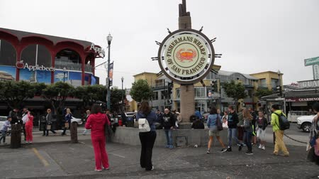 food state : San Francisco, California, United States - August 14, 2016: people at Fishermans Wharf square under the famous signboard of San Francisco. Fishermans Wharf is a neighborhood and famous waterfront.