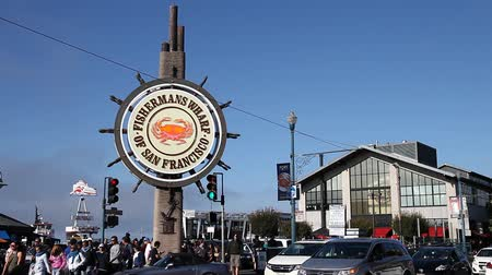 rákok : San Francisco, California, United States - August 14, 2016: people and traffic at Fishermans Wharf of San Francisco. Fishermans Wharf is a neighborhood and famous waterfront. Urban street view. Stock mozgókép