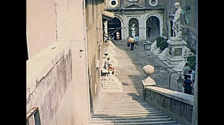 восстановлено : ROME, ITALY - CIRCA 1967: Historic restored footage on 1967. tourists inside the Castel SantAngelo castle in Rome city, Italy, located beside Tiber river. Medieval architecture and statues.