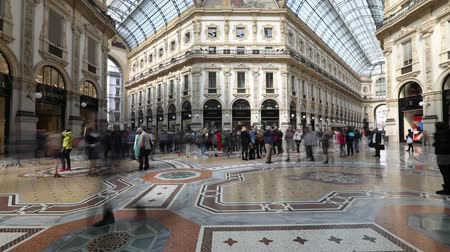galleria vittorio emanuele ii : MILAN, ITALY- MARCH 7, 2017: time lapse of the Galleria Vittorio Emanuele II arcaded mall with people and famous fashion stores like Prada, in Dome square. Luxury, leisure and shopping concept.