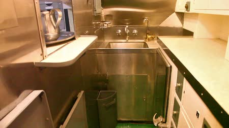 food state : HONOLULU, OAHU, HAWAII, USA - AUGUST 21, 2016: kitchen room with sink of USS Bowfin Submarine SS-287 at Pearl Harbor. Historic Landmark of the Japanese attack in WW II.
