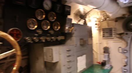 ss : HONOLULU, OAHU, HAWAII, USA - AUGUST 21, 2016: control room with levers, wheels and a table in USS Bowfin Submarine SS-287 at Pearl Harbor. With levers and measurement instruments of control. Stock Footage