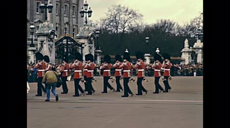buckingham palace : LONDON, UNITED KINGDOM - CIRCA 1979: Trooping the Colour Ceremony at Buckingham Palace of British Army Commonwealth. Historic restored footage on 1970s.