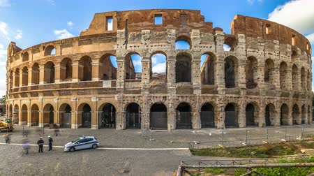 flavium : Rome, Italy - May 12, 2016: sunset with clouds hyper lapse in 4K: tourists visiting the Colosseum, Flavian Amphitheatre, the largest amphitheater in the world and one of the symbols of Italy and Rome.