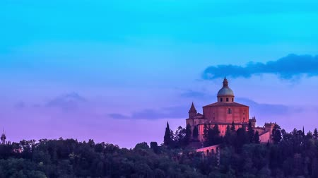 luke : San Luca basilica church on Bologna hill, in a colorful twilight. time lapse in 4K
