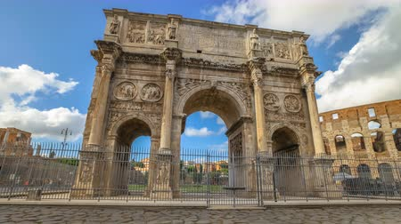 costantino : sunset with clouds time lapse in 4K of Arch of Constantine, located between Colosseum and the Arch of Titus on the Roman road, built to celebrate the triumph of the emperor Constantine. Rome, Italy.