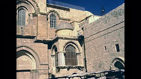 sepulcher : Church of the Holy Sepulchre in the Muristan area of the christian district. Old City of Jerusalem. Historic restored footage on 1980s in Israel.