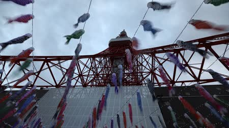 prospective : Tokyo, Japan - April 23, 2017: bottom time lapse of colorful Koinobori at Tokyo Tower. Koinobori are carp-shaped wind socks traditionally flown in Japan to celebrate Childrens Day during Golden Week