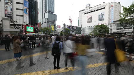 busiest : Tokyo, Japan - April 22, 2017: unidentified pedestrians time lapse in Shibuya Crossing, one of the busiest crosswalks in the world. Shibuya is one of Tokyos most famous neighborhoods.