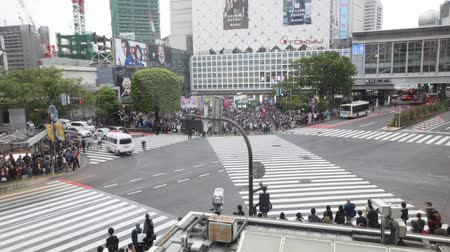 busiest : Tokyo, Japan - April 22, 2017: aerial view time lapse from Starbucks in front of Shibuya Station of popular Shibuya Crossing, one of the busiest crosswalks in the world.