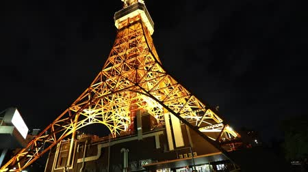 prospective : Perspective view of Tokyo Tower illuminated at night. The Tokyo Tower is a telecommunications building and also a panoramic observatory located in Minato district, Tokyo, Japan.