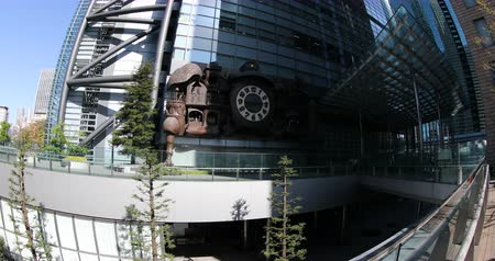 prospective : Tokyo, Japan - April 20, 2017: prospective view of victorian steampunk Giant Ghibli clock. The clock is located in front of Nittele Tower (Nippon Television headquarters) in Shiodome area, Minato ward