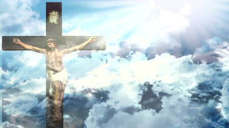 keresztre feszítés : Jesus Christ resurrection in Easter, cross of Jesus Christ on sky background with moving clouds a shining celestial light from above.