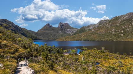 tasmania : The walkway up to Cradle Mountain National Park, Tasmania, Australia in Lake Dove Circuit with moving clouds timelapse in the sky