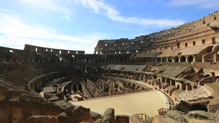 flavium : Rome, Italy - May 12, 2016: Rome coliseum interior with tourists visiting, Flavian Amphitheatre, the largest amphitheater in the world and one of the symbols of Italy and Rome. Stock Footage