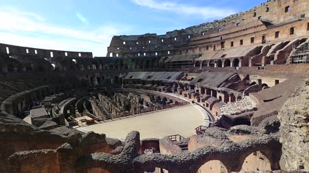 flavium : Rome, Italy - May 12, 2016: Rome coliseum interior with tourists, 180 degrees panorama, the colosseo is the largest amphitheater in the world and one of the symbols of Italy and Rome.