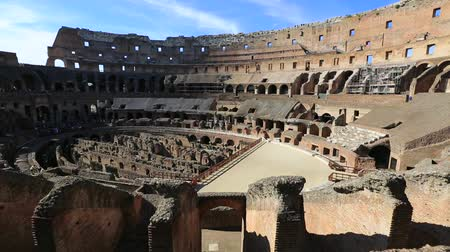 flavium : Rome, Italy - May 12, 2016: Rome coliseum interior with tourists, panorama, the colosseo is the largest amphitheater in the world and one of the symbols of Italy and Rome.