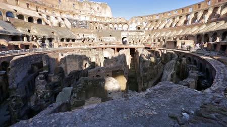flavium : Rome, Italy - May 12, 2016: Rome coliseum interior with tourists, 180 degrees panorama, the colosseum is the symbols of Italy and Rome.