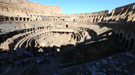 flavium : Rome, Italy - May 12, 2016: Rome colosseo interior with tourists, 180 degrees panorama, the colosseo is the largest amphitheater in the world and one of the symbols of Italy and Rome.